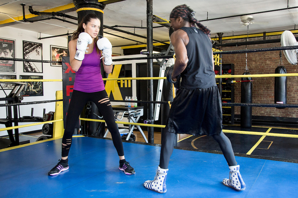 Supermodel Adriana Lima powers up for the launch of AMAZON Beverages with a boxing workout with trainer Michael Olajide in New York, September 9, 2013. INSIDER IMAGES/Gary He (UNITED STATES)